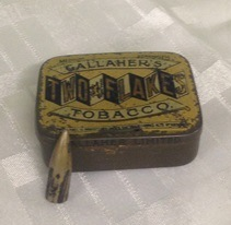 Hector Miller's bullet and tobacco tin